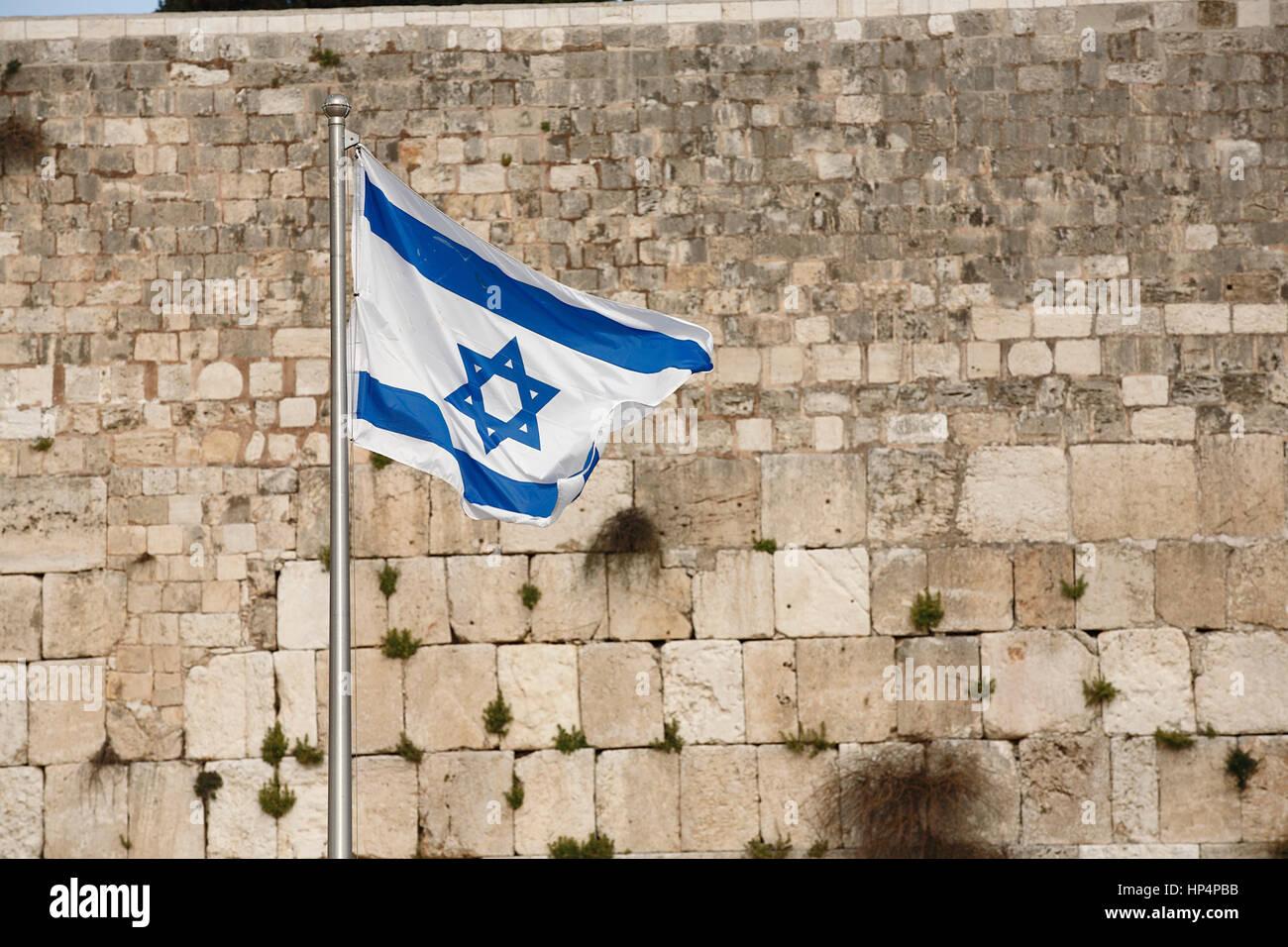flag of israel at flagpole at western wall, old city, jerusalem, israel - Stock Image