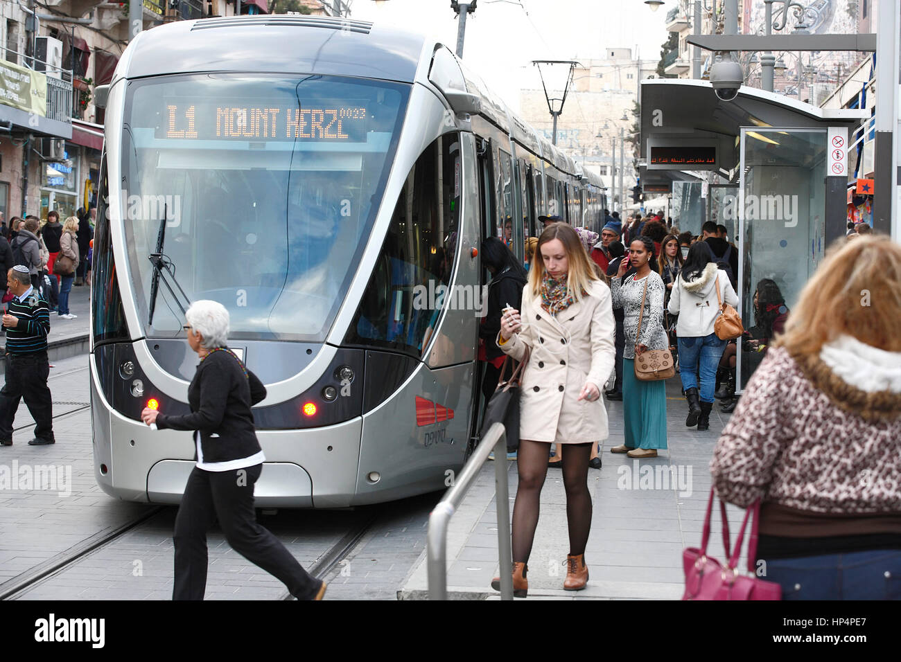 tram stop with people infront of Jerusalem Light Rail Transit (L 1)  at jaffa road in western part of new jerusalem, - Stock Image