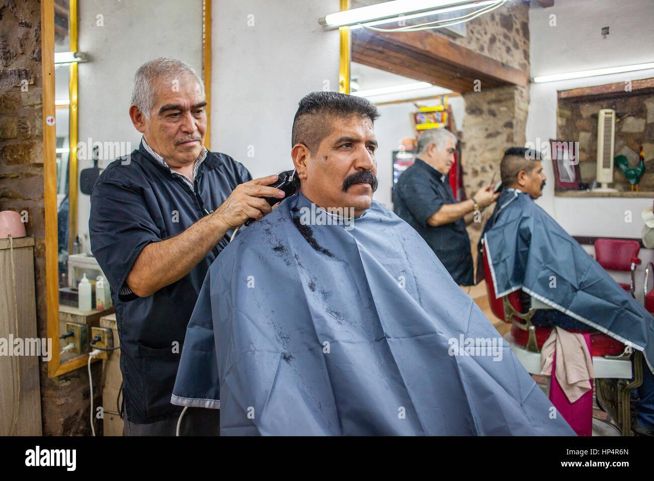 Barbershop in Juarez street at Juan Valle street, Guanajuato, state Guanajuato, Mexico - Stock Image