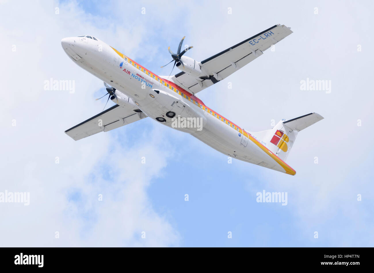 Plane ATR 72 600, of Air Nostrum airline, is taking off from Madrid - Barajas, Adolfo Suarez airport. Regional travels. - Stock Image