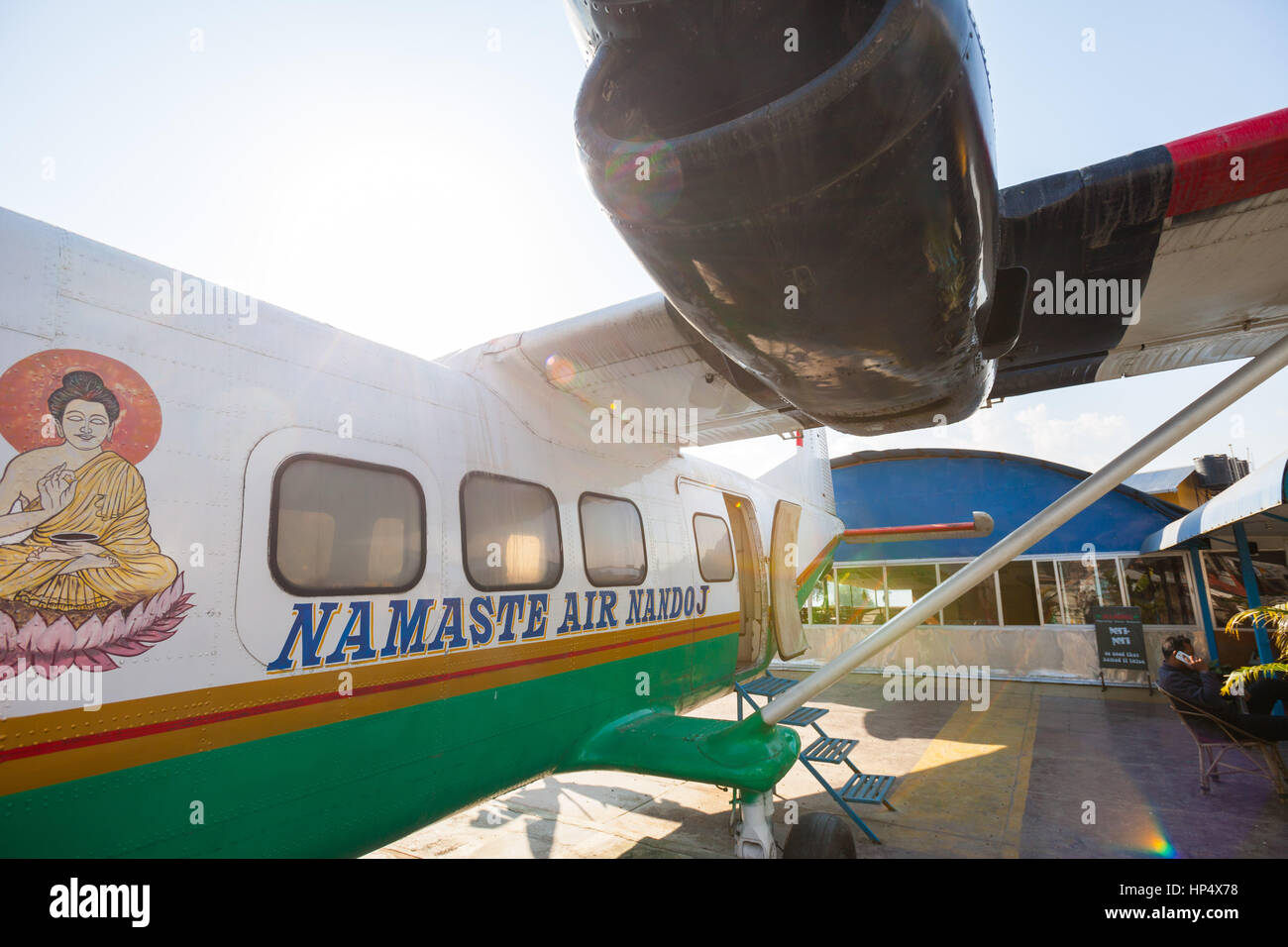 Guests sit down inside a remodeled, no longer in service airplane now used for restaurant seating at the Namaste - Stock Image