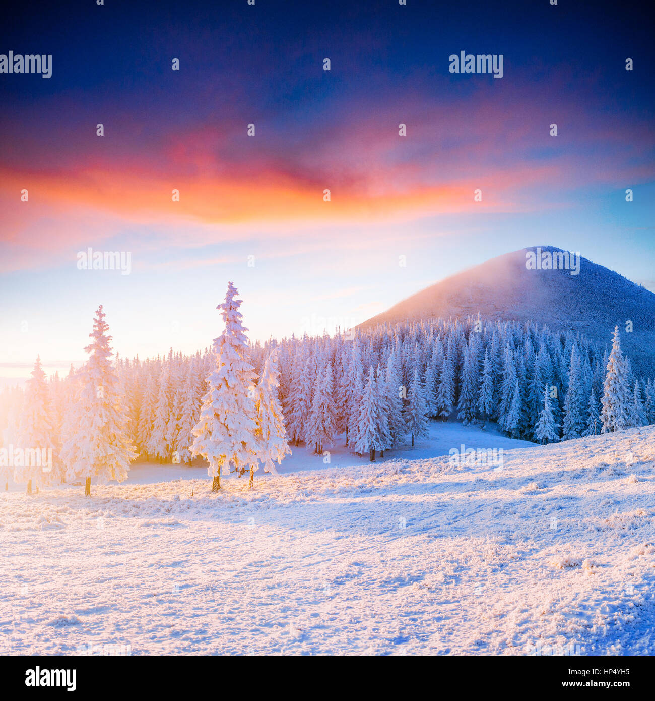 Colorful sunset over the mountain ranges in the national park - Stock Image