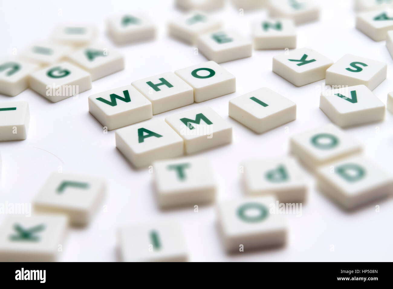 Text - Who am I made of single letter block with tilt-shift and shallow depth of field. - Stock Image