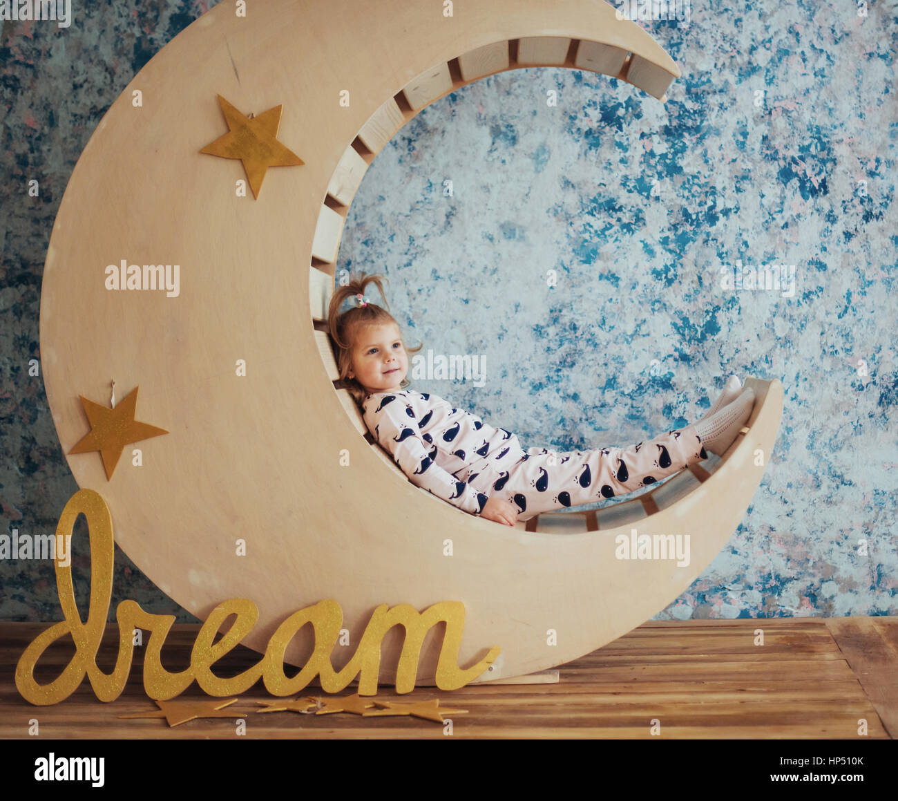 Child in soft and warm pajamas lying - Stock Image