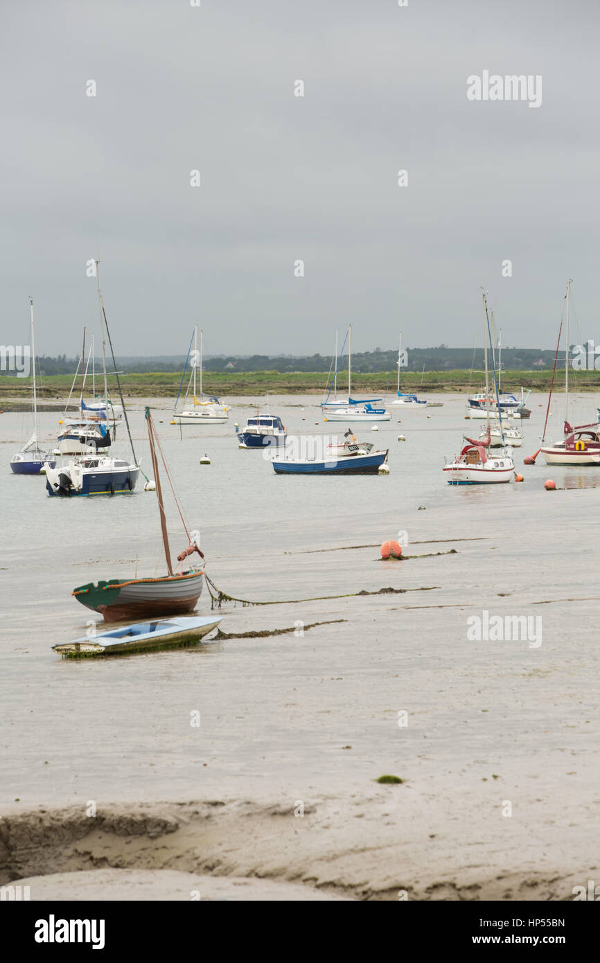 Boats anchored in the estuary of the Blackwater and Colne rivers at West Mersea, UK. Unsharpened - Stock Image