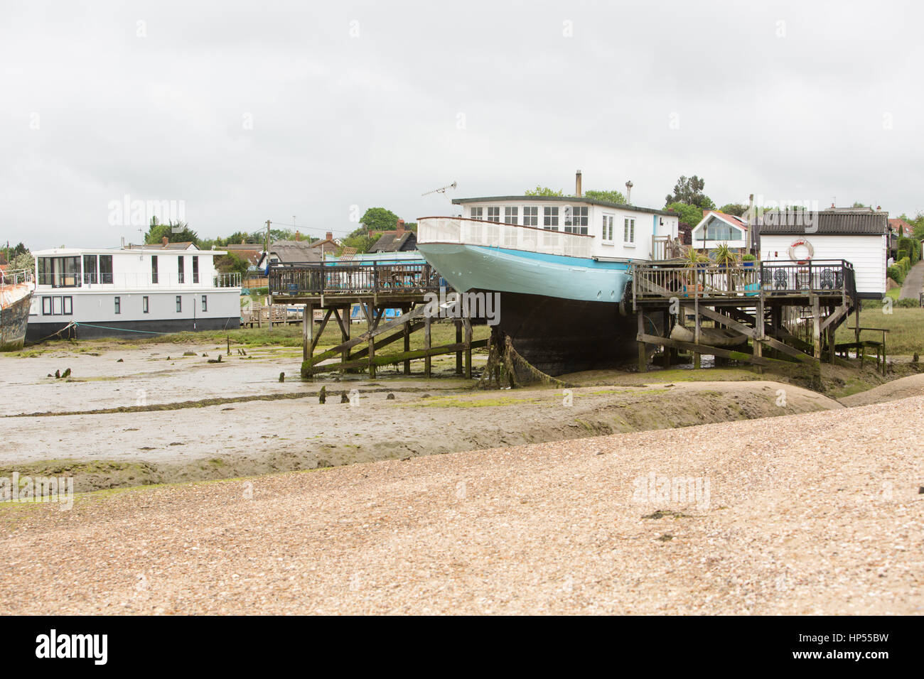 House boats at West Mersea, on estuary of the Blackwater and Colne rivers, Essex coast, UK. Unsharpened - Stock Image