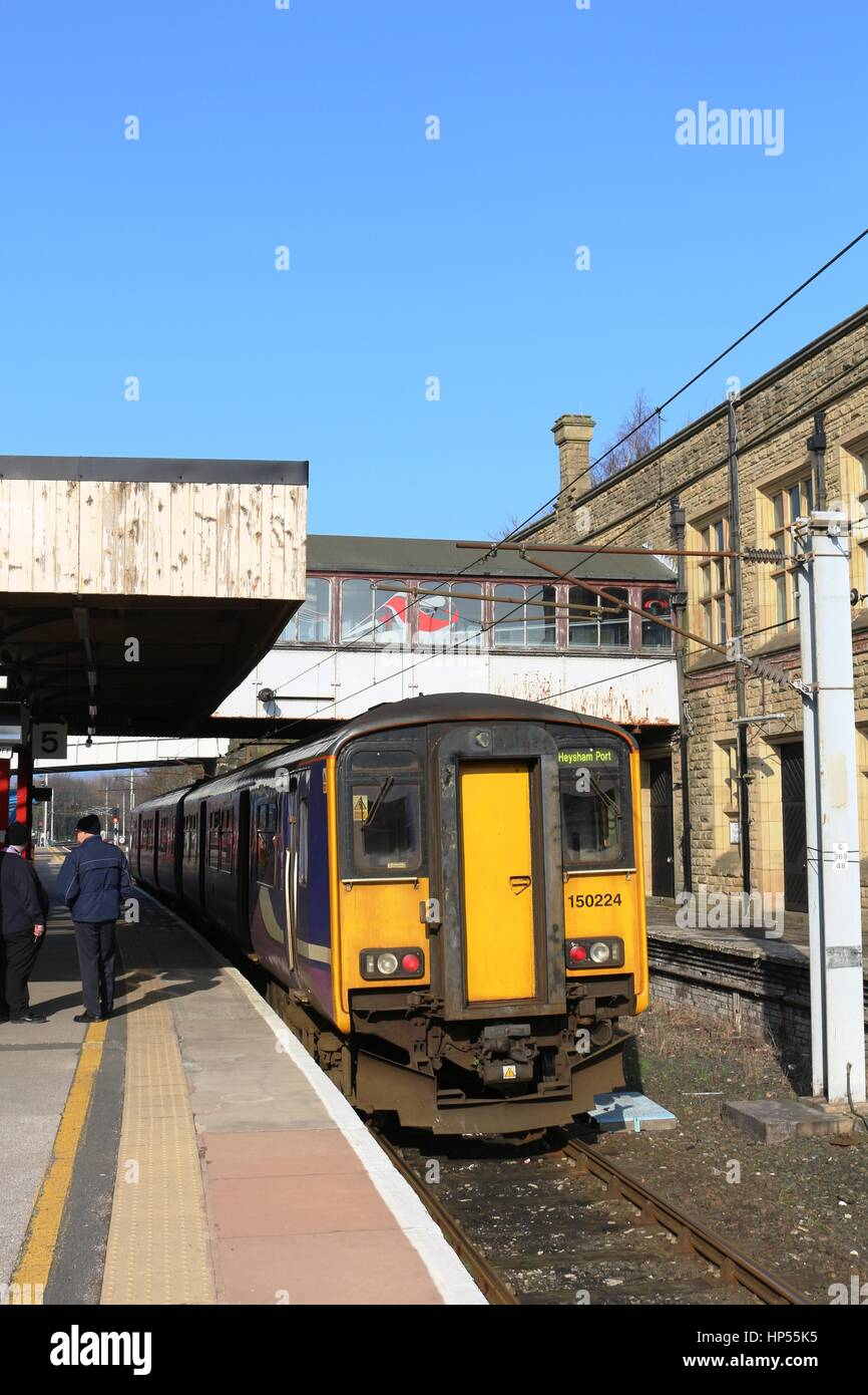 Class 150 diesel multiple unit train at platform 5 Lancaster railway station with a Northern Leeds to Heysham Port - Stock Image