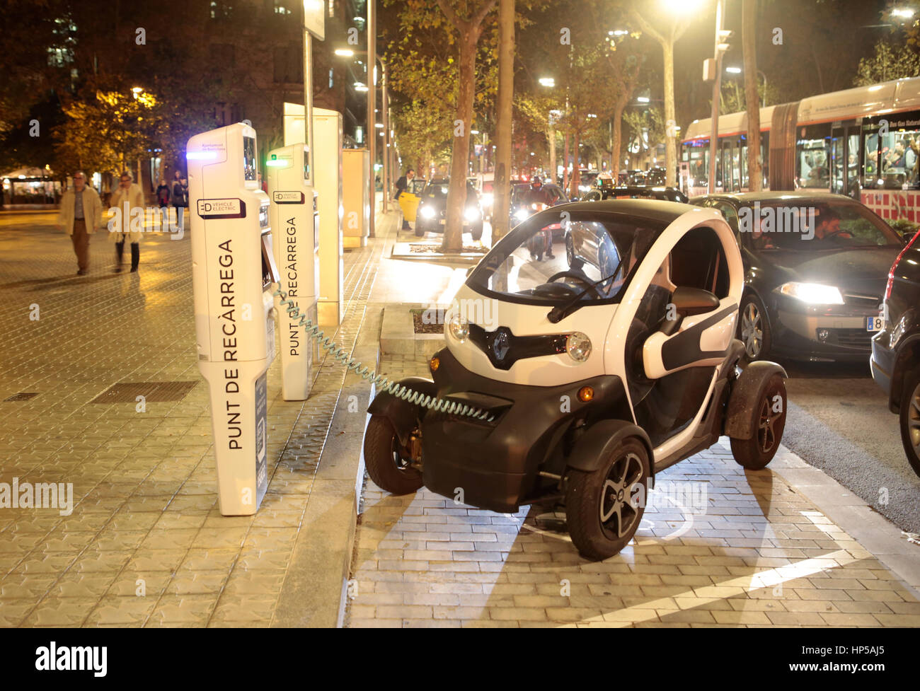 electric car in a public recharge point in Barcelona - Stock Image