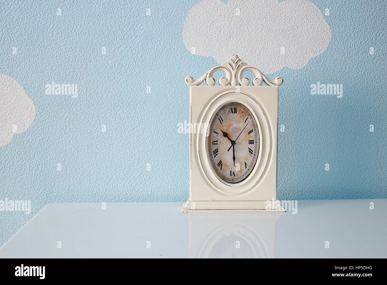 Clock in the nursery room. - Stock Image