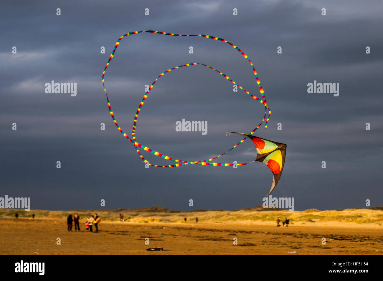 Southport, Merseyside, UK.  Weather. 18th February, 2017. 12C. as Precision Stunt Kites fly on Ainsdale Beach. Barmy Stock Photo