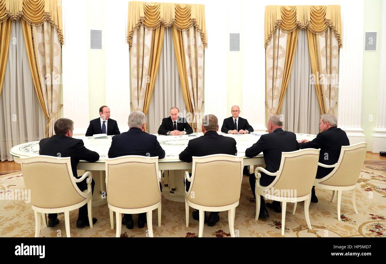 Russian President Vladimir Putin meets with the retired governors of Buryatia, Karelia, Perm Territory, Novgorod Stock Photo