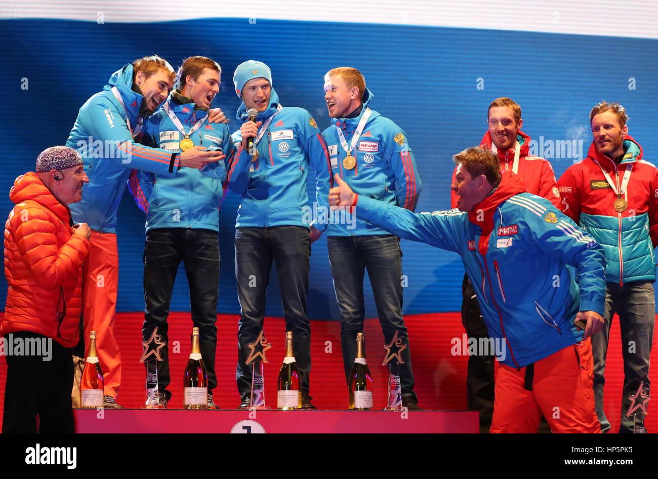 Hochfilzen, Austria. 18th Feb, 2017. Russian TV commentator Dmitry Guberniyev (R front) helps gold medallists Anton - Stock Image