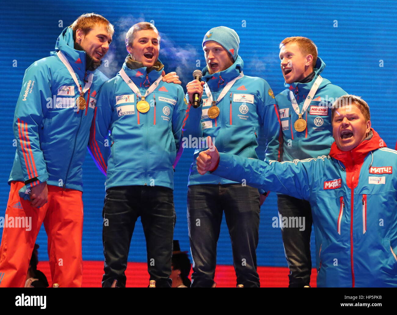 Hochfilzen, Austria. 18th Feb, 2017. Russian TV commentator Dmitry Guberniyev (front) helps gold medallists Anton - Stock Image
