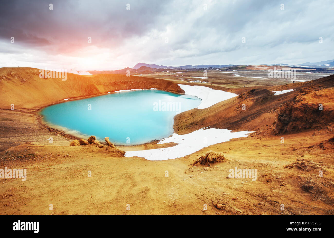 Giant volcano overlooks. Turquoise provides a warm geothermal wa - Stock Image