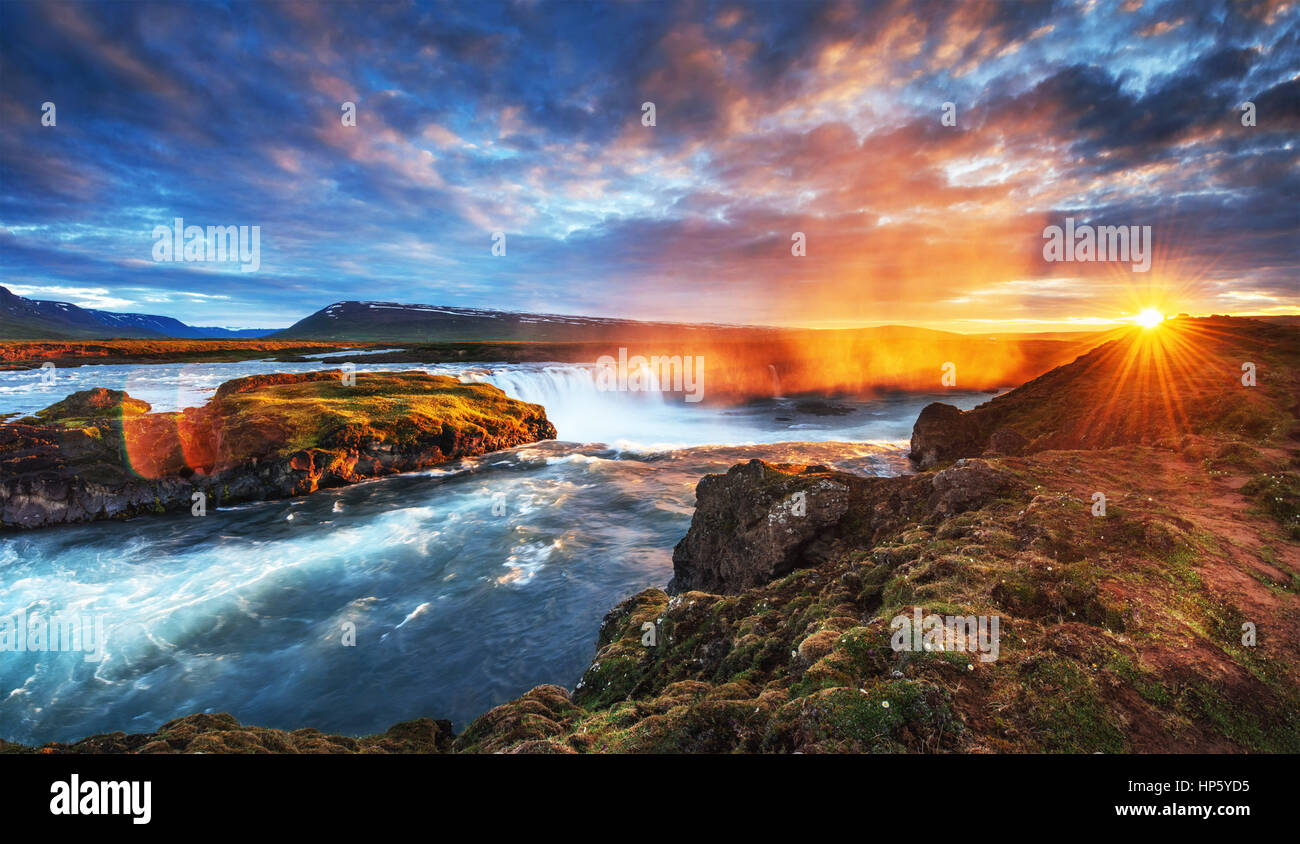 The picturesque sunset over landscapes and waterfalls. Kirkjufel - Stock Image