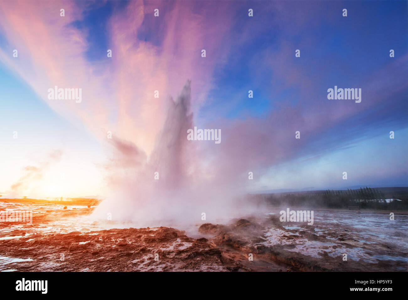 Strokkur geyser eruption in Iceland. Fantastic colors shine thro - Stock Image