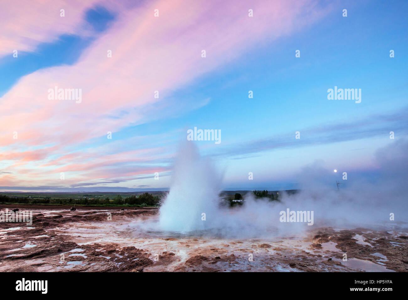Strokkur geyser eruption in Iceland. Fantastic colors shine thro - Stock Image