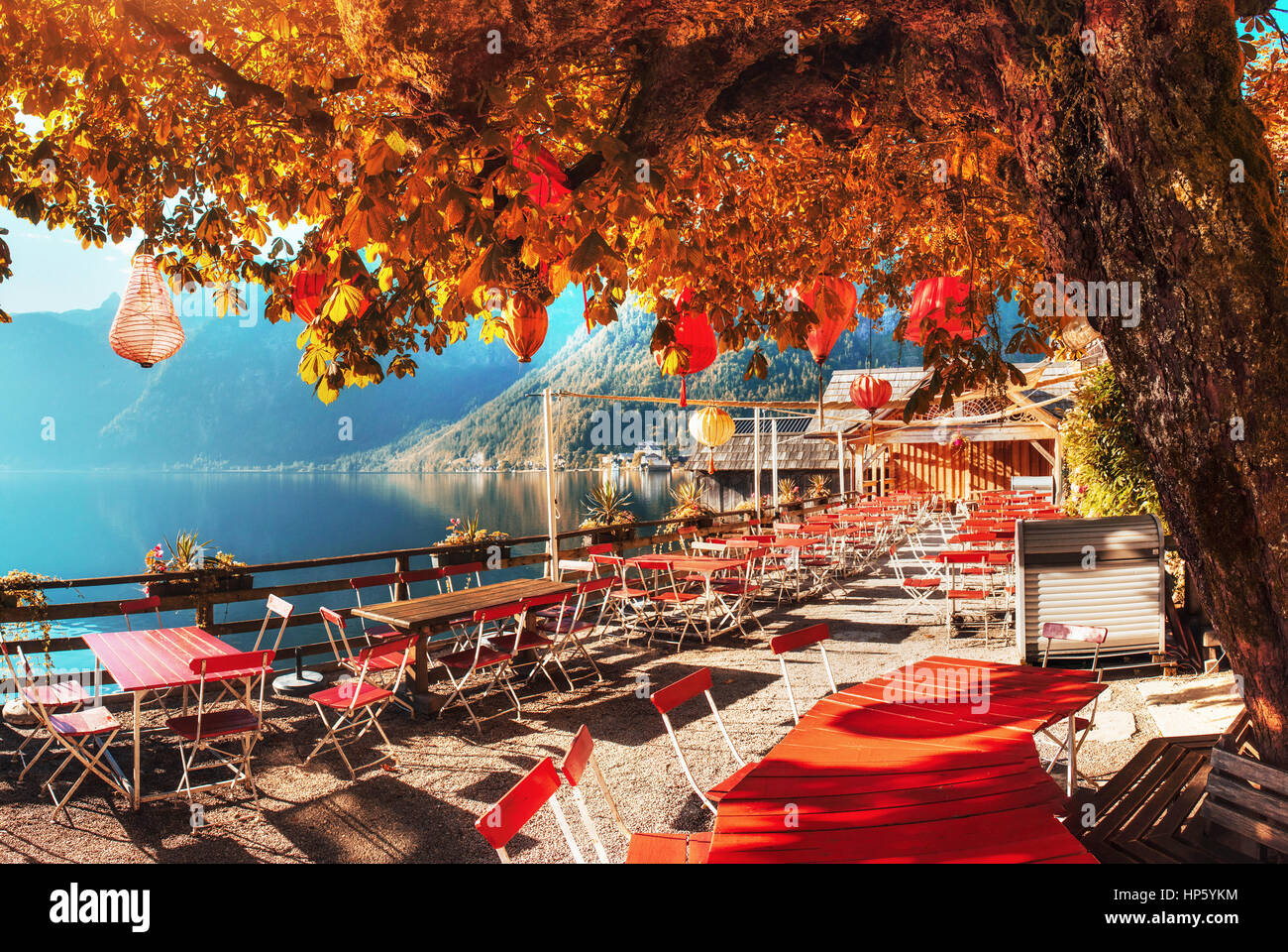 Summer cafe on the beautiful lake between mountains. Alps. Halls Stock Photo