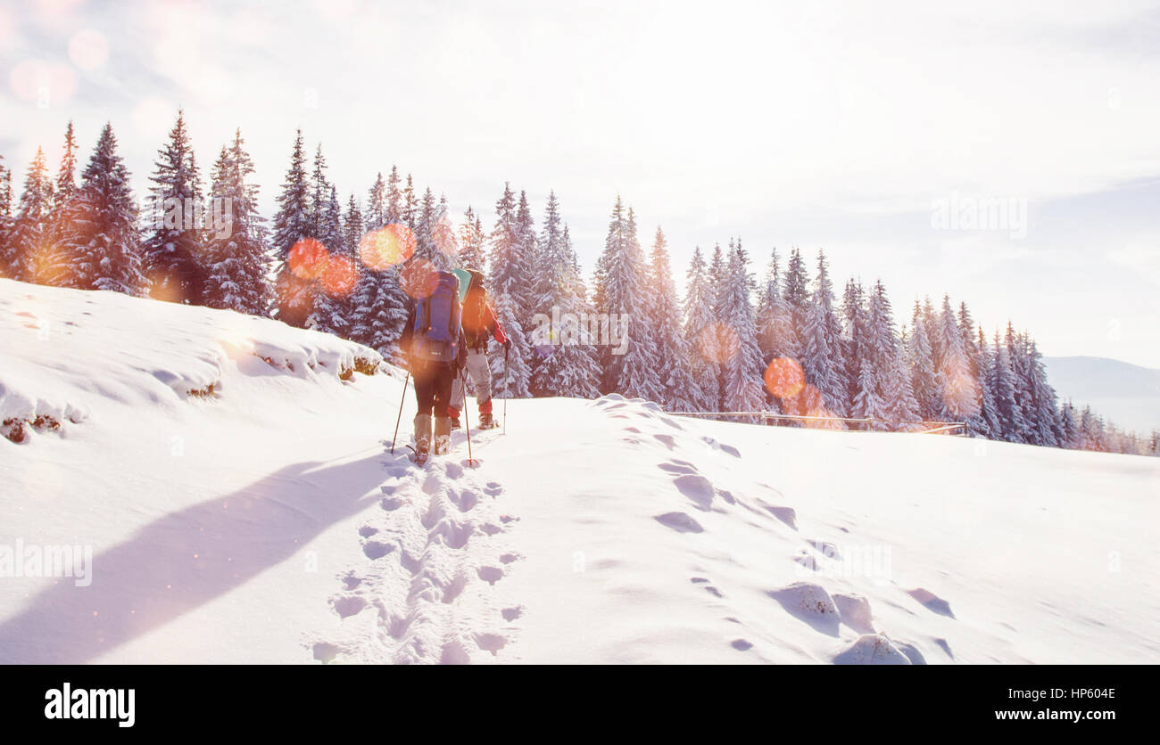 tourist is in winter mountains.  Bokeh light effect, soft filter - Stock Image