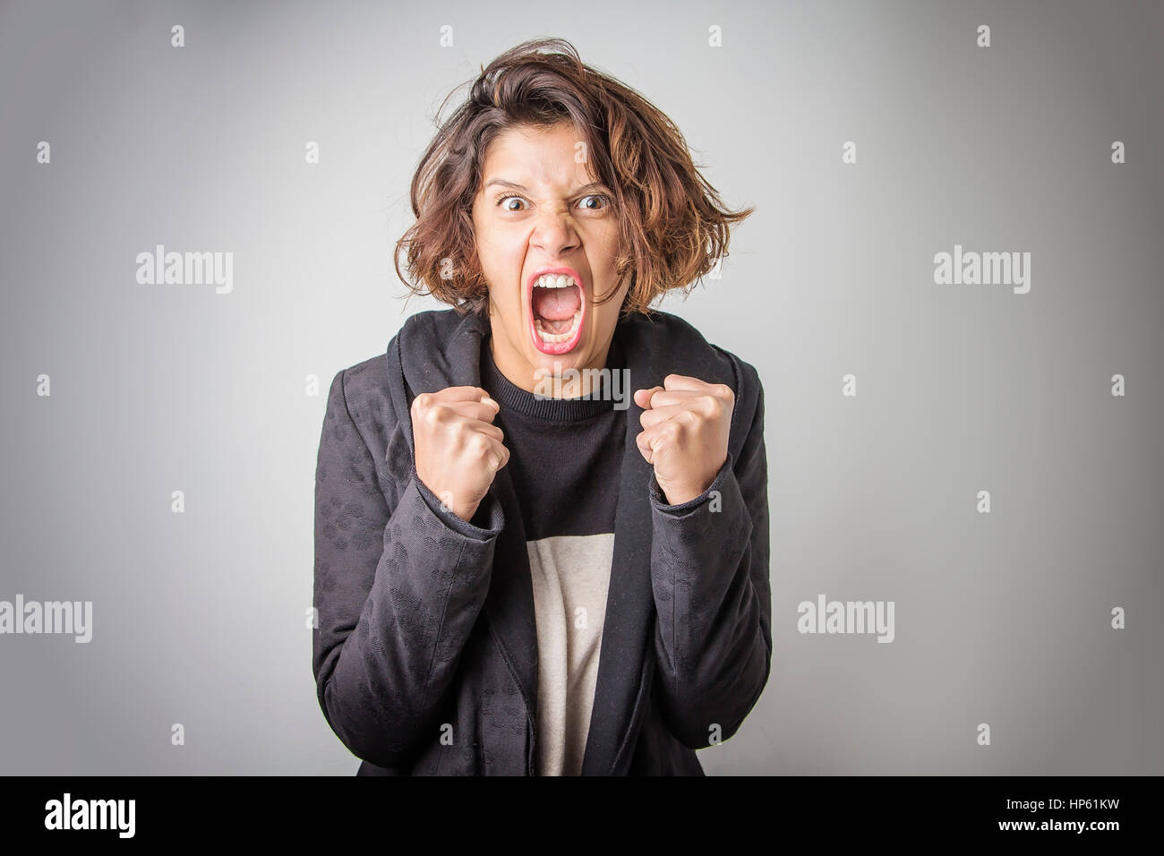 Furious angry woman screaming with rage and frustration - Stock Image