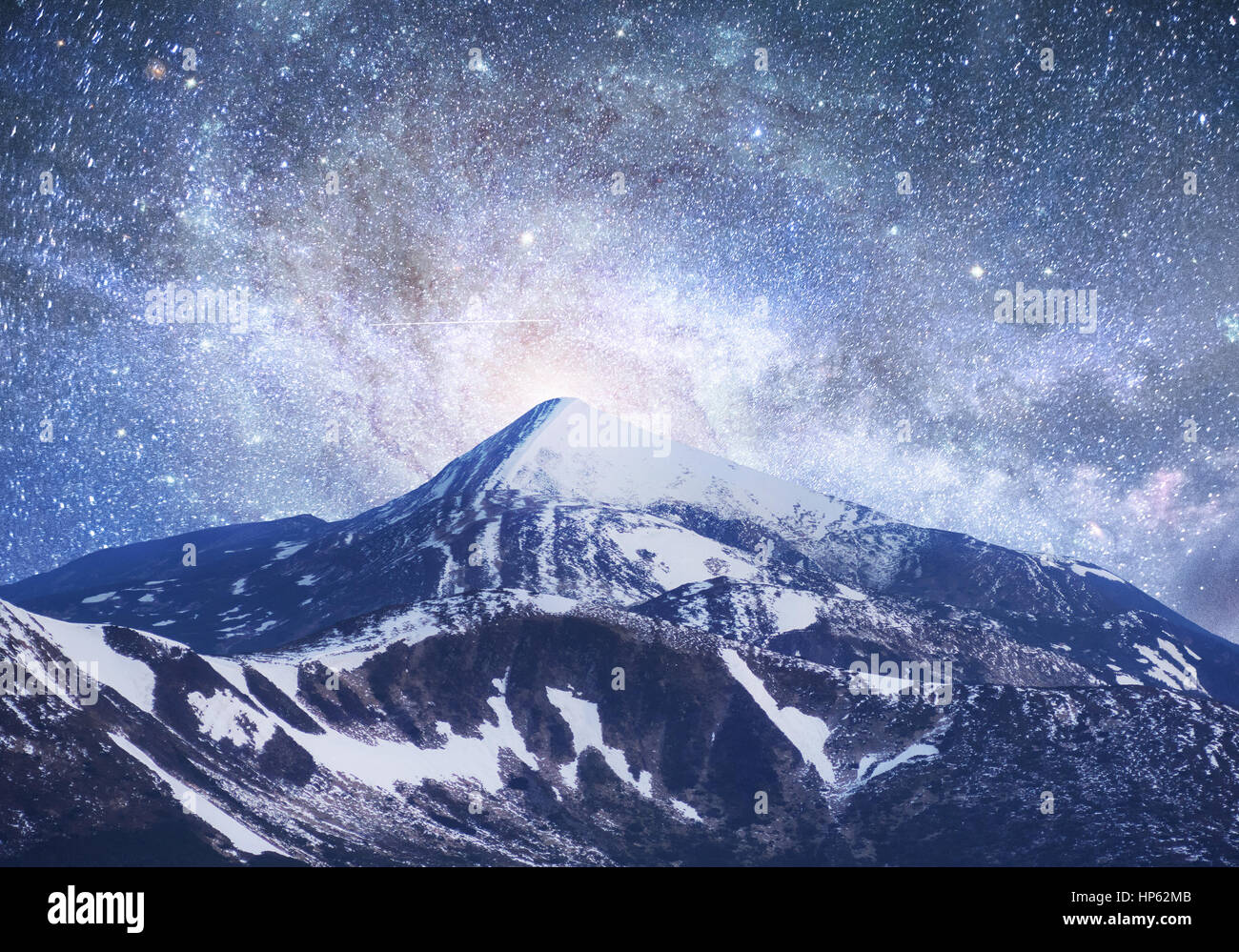Fantastic starry sky. Beautiful winter landscape and snow-capped - Stock Image