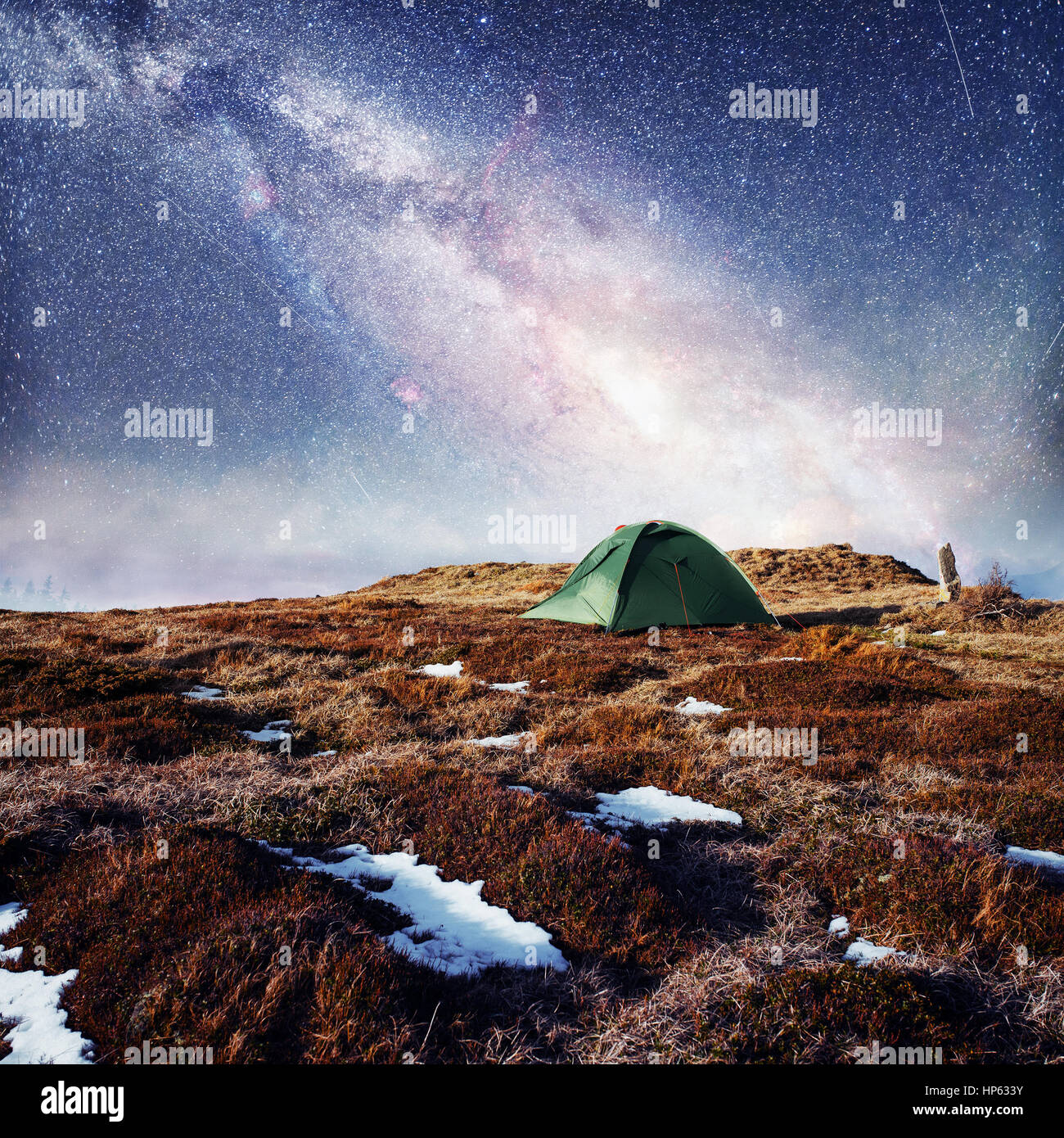 the starry sky above the tent in the mountains. Magic event in f - Stock Image