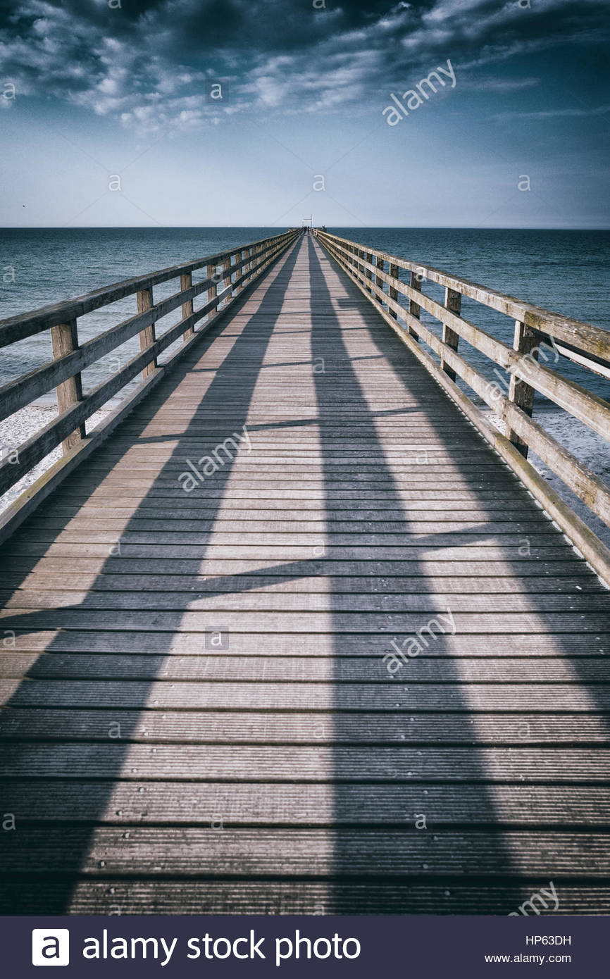 Pier jetty diminishing perspective wooden ocean - Stock Image