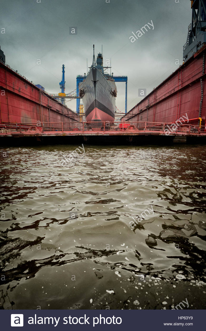 Dry dock large ship bow navy repairing re-fitting - Stock Image