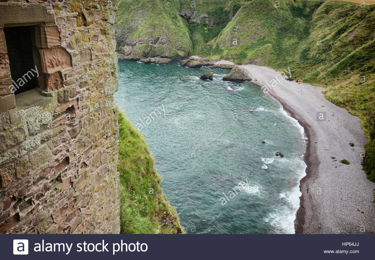 Castle wall cliffs beach waves from above view Stock Photo