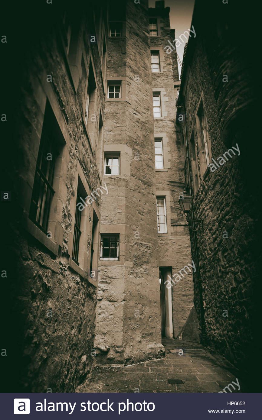 Tenement building sepia dark alley narrow spooky - Stock Image