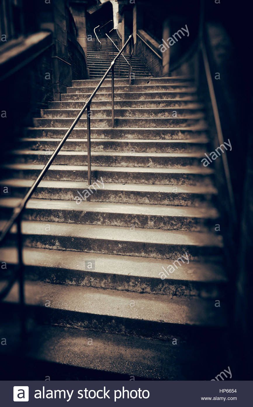 Stairs dark spooky dull scary empty steps narrow - Stock Image