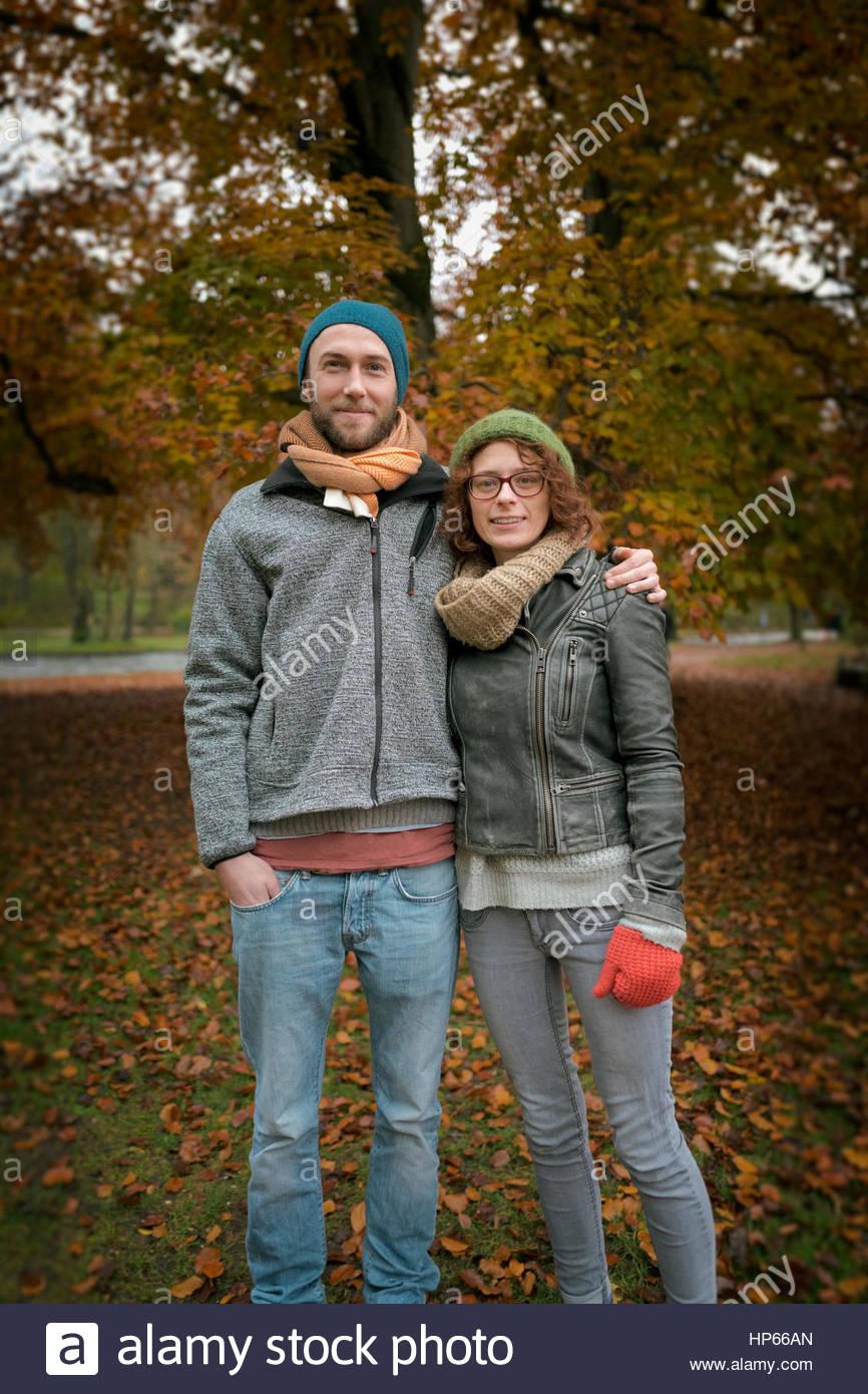 Young heterosexual couple autumn smiling 20s 30s - Stock Image