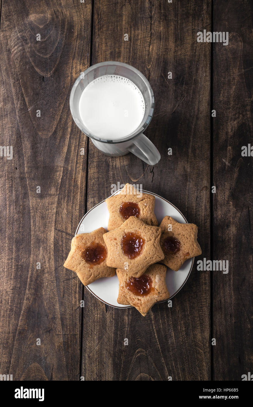 Fresh cookies with fruit jelly over rustic wooden background, from above Stock Photo