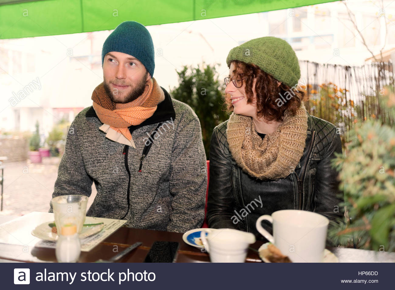 Young heterosexual couple winter cafe in love 30s - Stock Image