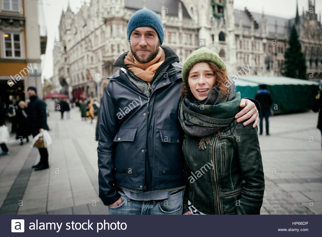 Young heterosexual couple sightseeing city tour - Stock Image