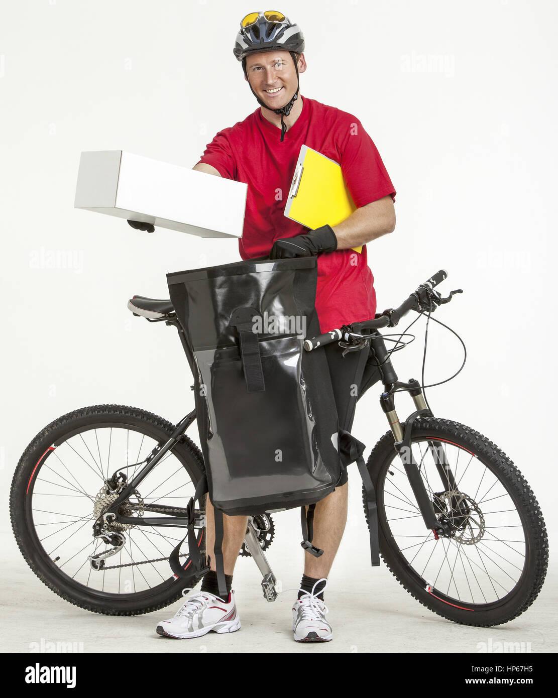 Fahrradkurier liefert Paeckchen aus (model-released) Stock Photo