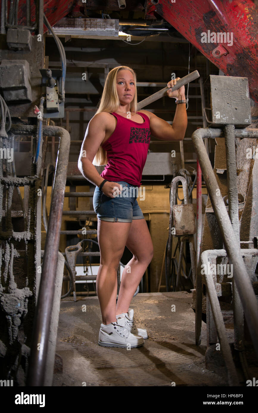 Fit woman industrial background - Stock Image