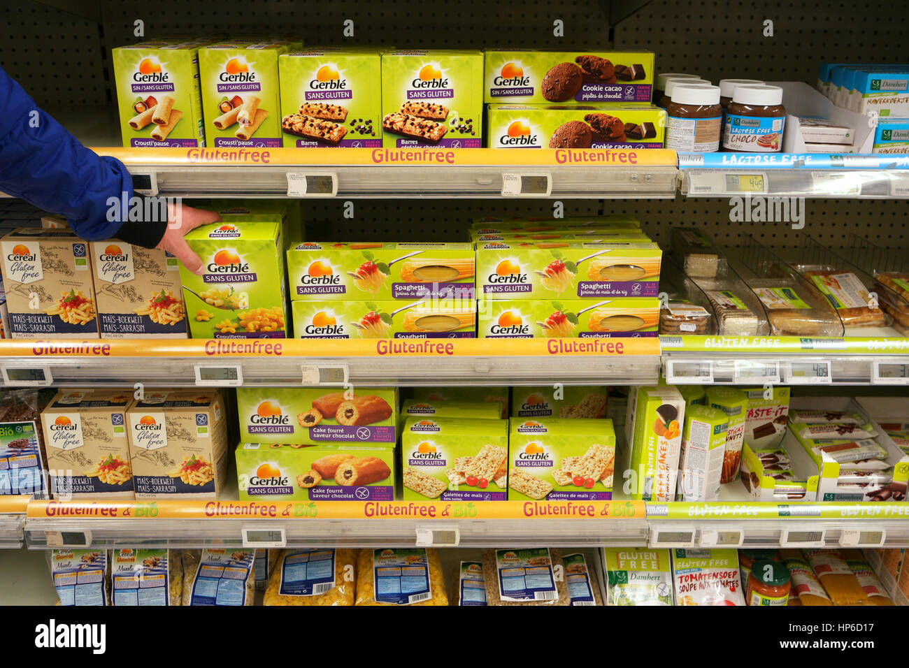 Shelves with various glutenfree products in a Supermarket. - Stock Image