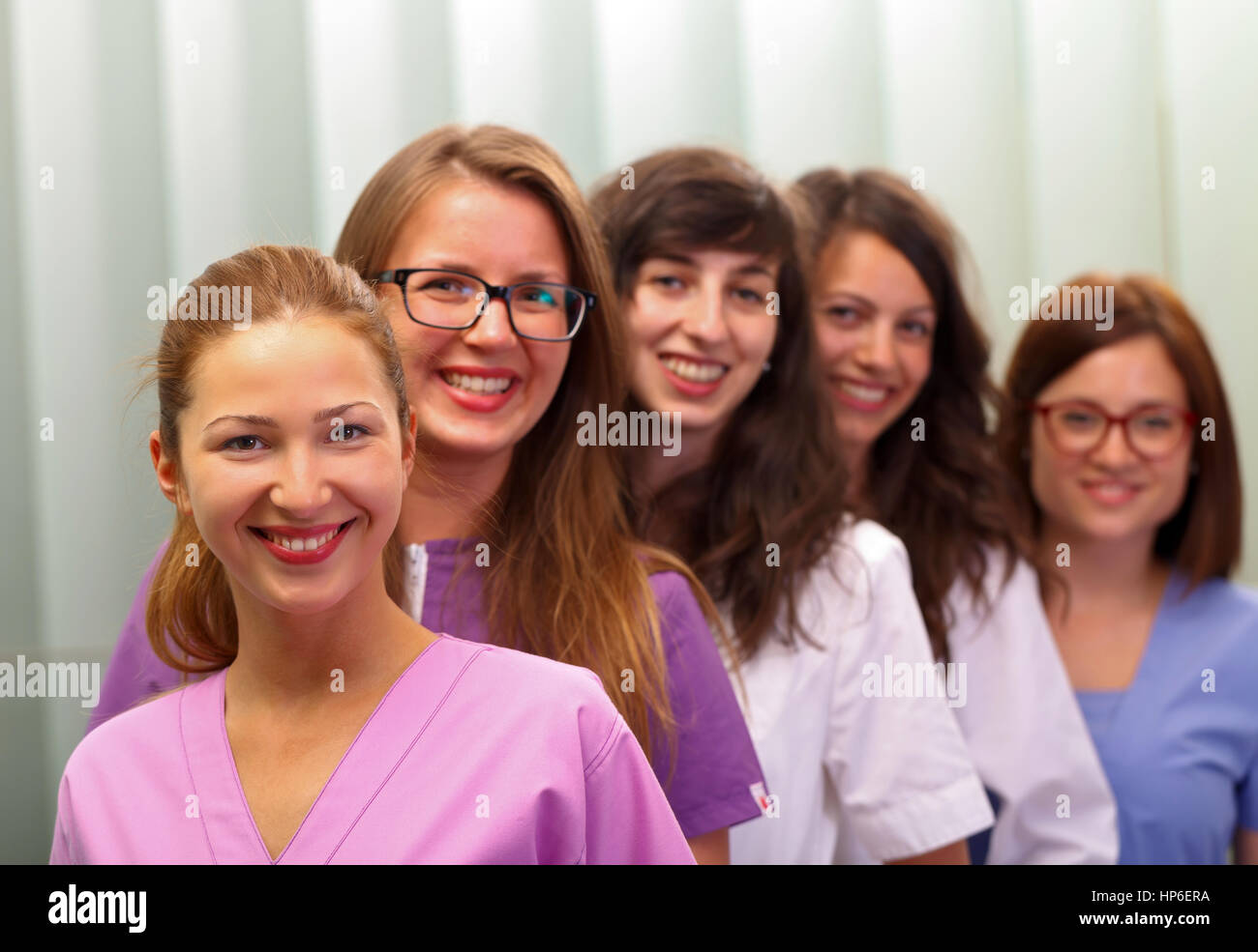 Beautiful female doctors standing in the office - Stock Image