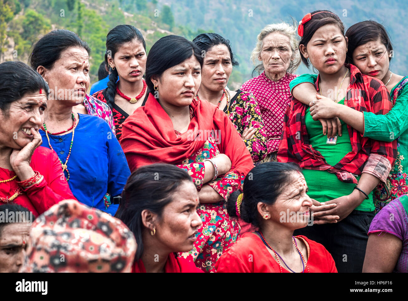 Local women gather in a public meeting in rural Nepal to discuss the earthquake recovery progress and water resource - Stock Image