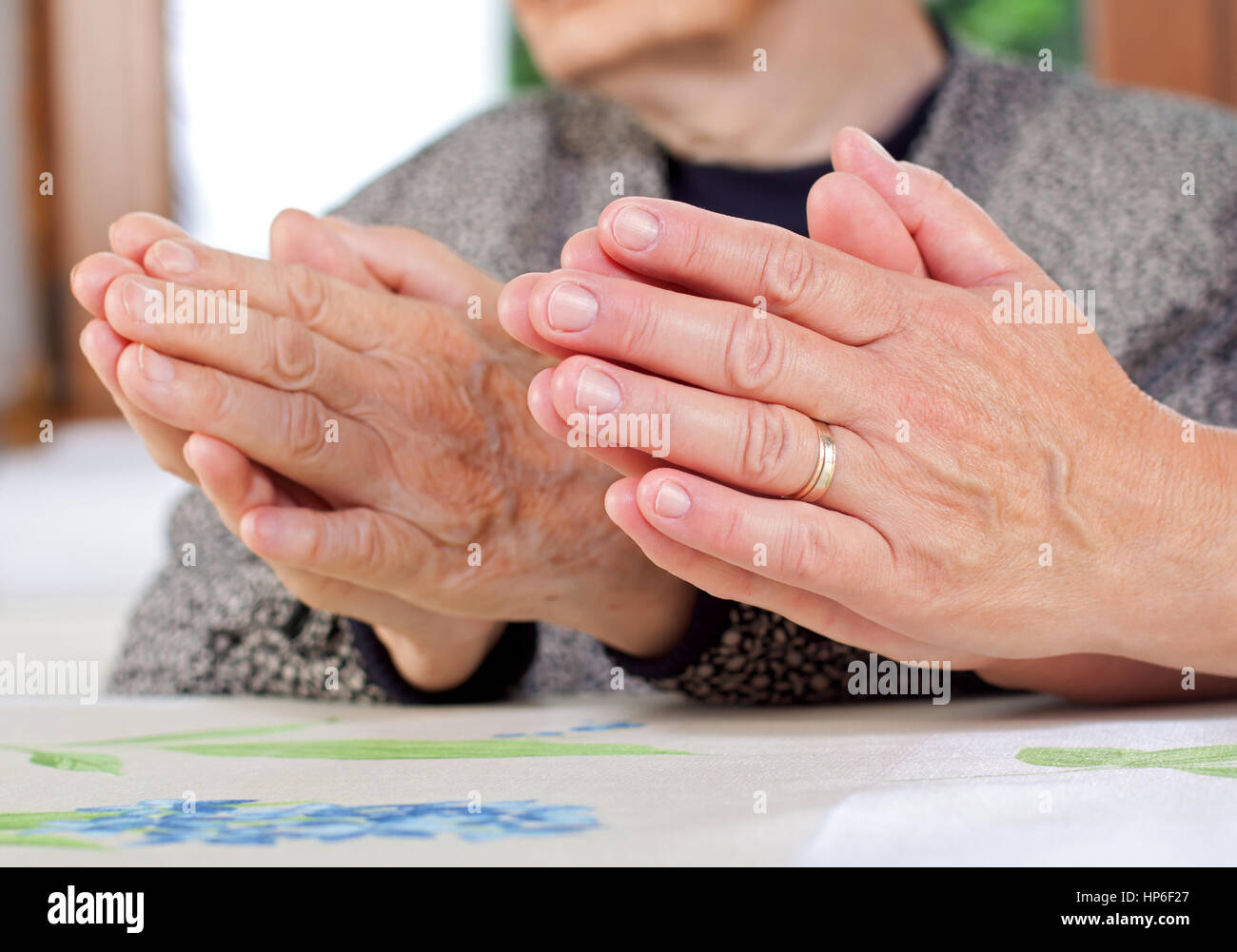 Picture of a doctor and a patient hand praying together - Stock Image