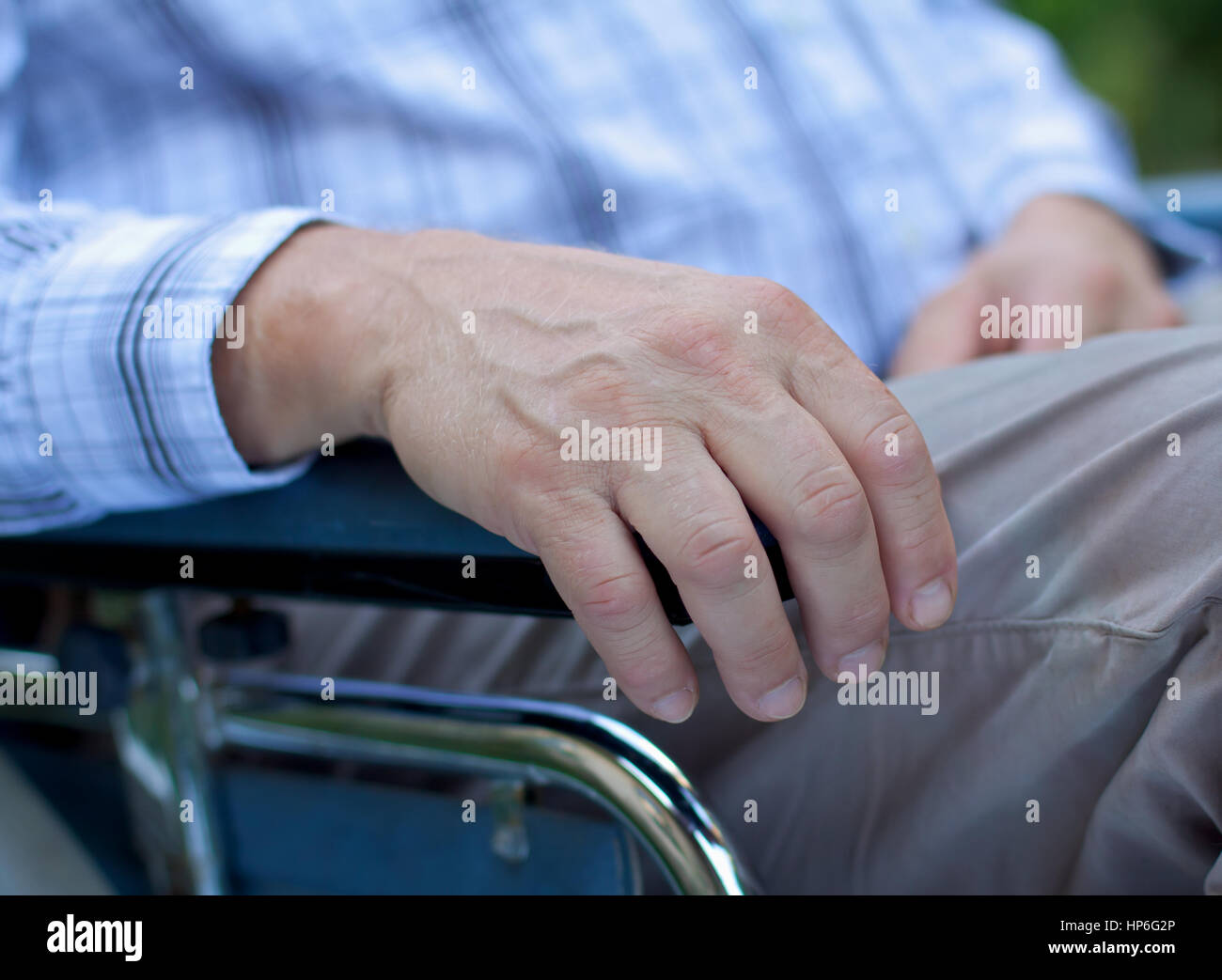 Handicapped elderly man sitting in a wheelchair Stock Photo
