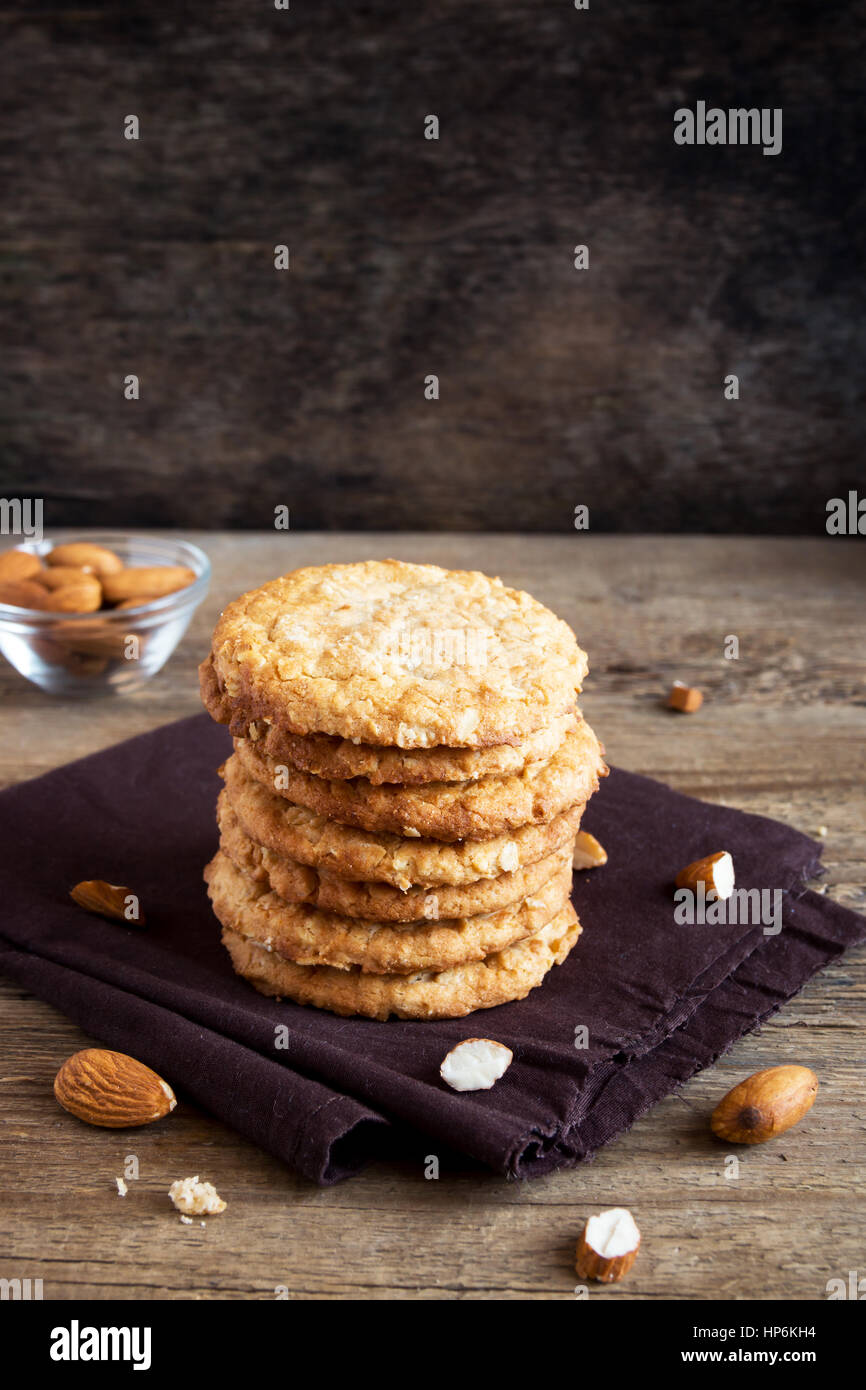 Homemade almond cookies on wooden table - healthy homemade vegan vegetarian pastry with almonds nuts - Stock Image
