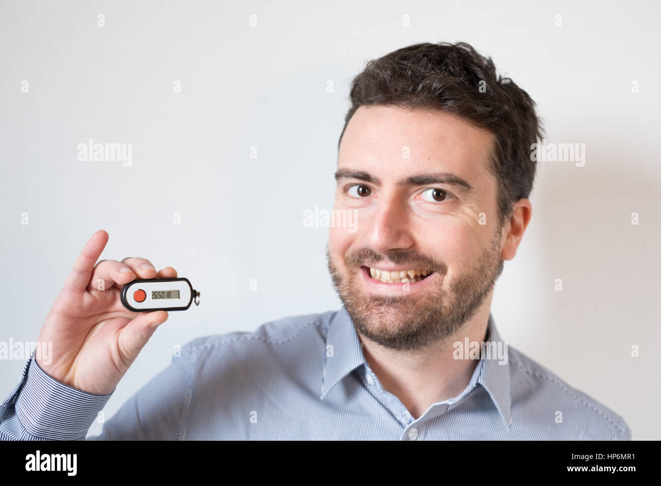 Man holding a security banking pin generator - Stock Image