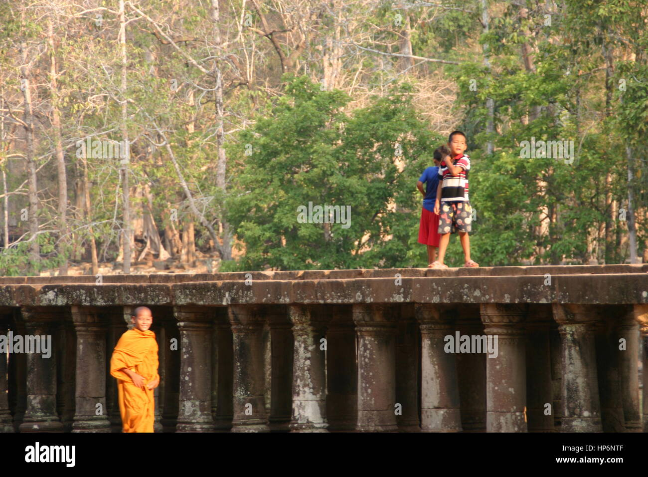 Young child monk walking in Angkor Wat Cambodia - Stock Image