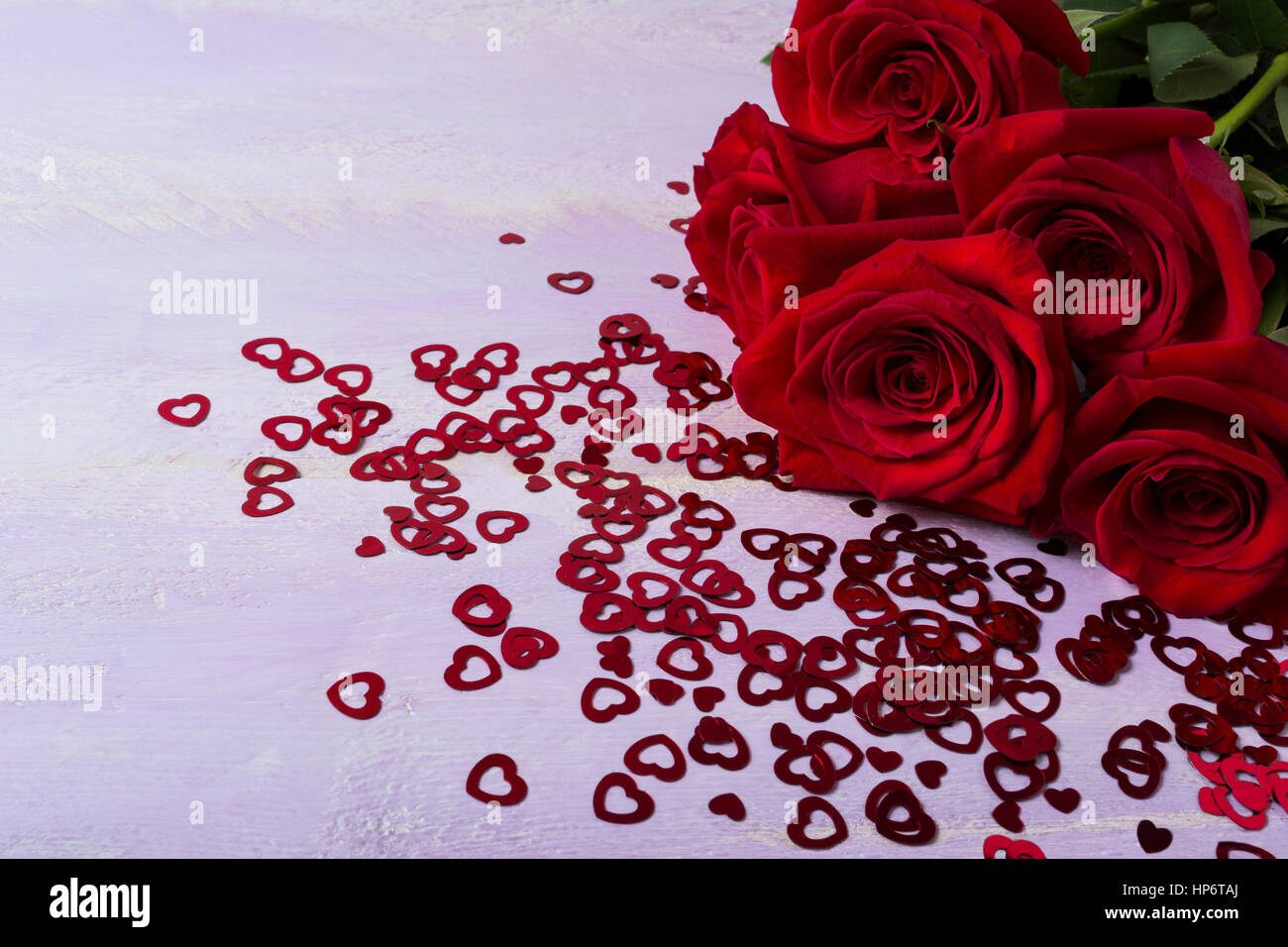 Bunch of burgundy roses on lilac background. St. Valentine Day red ...