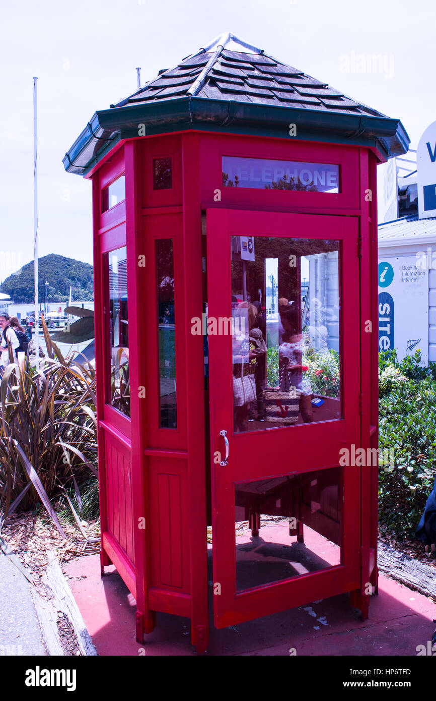 Red phone box at Paihia New Zealand - Stock Image