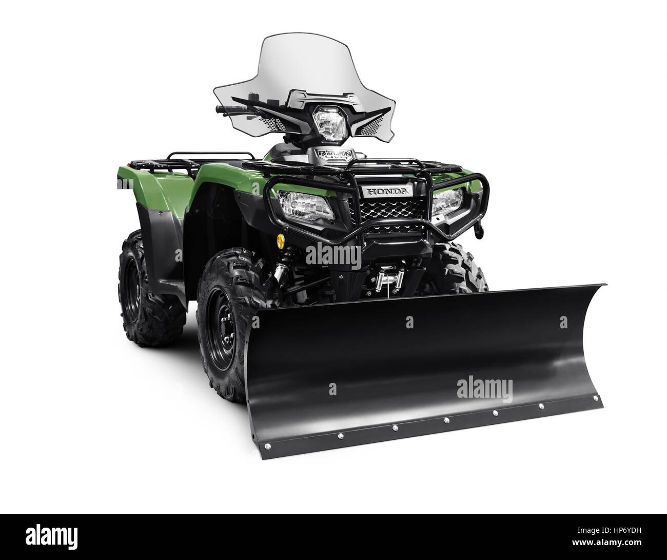 2017 Honda Rubicon Foreman 500 4x4 ATV with snow plow blade isolated on white background with clipping path - Stock Image