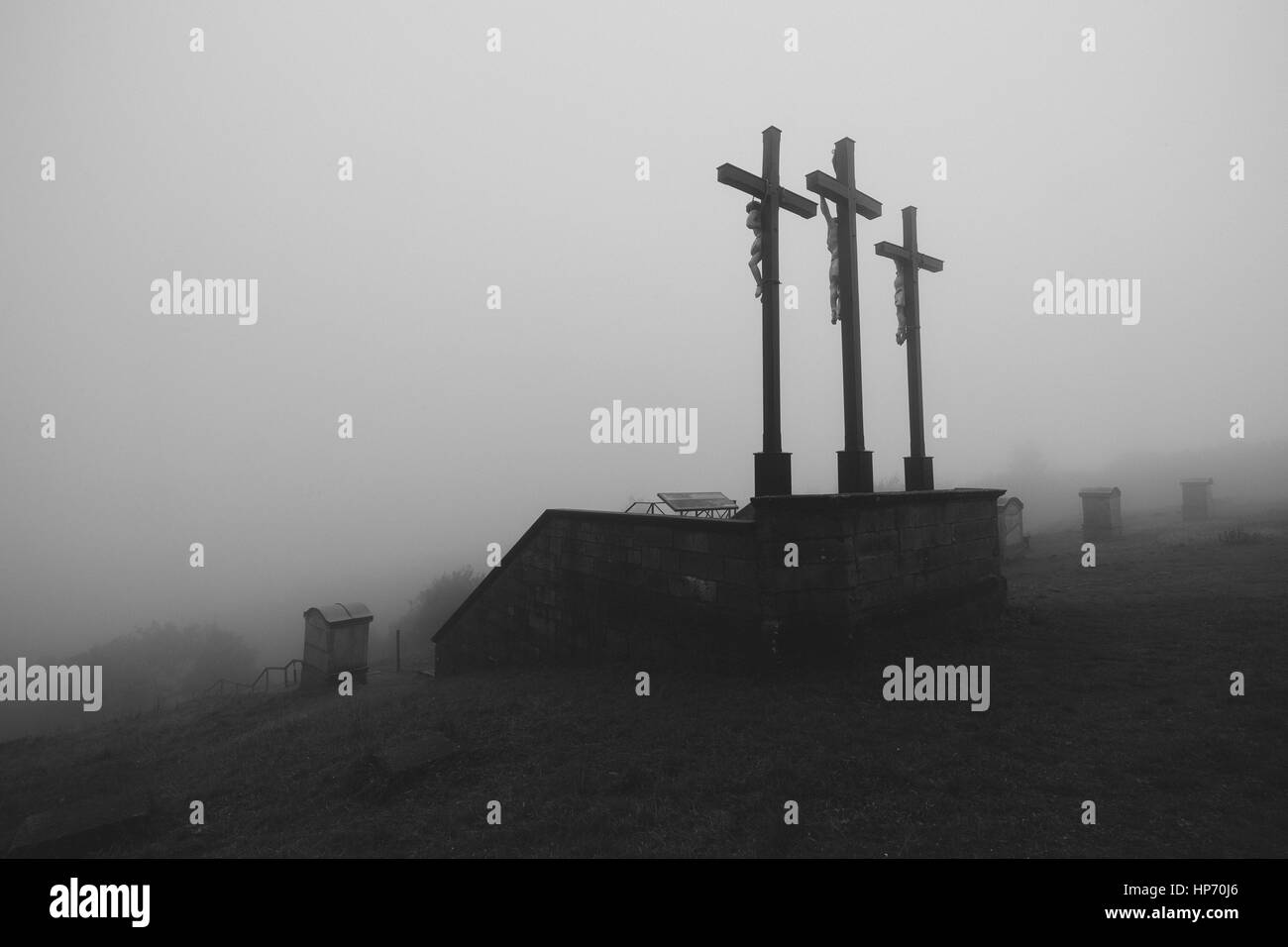 Crucifixes in the fog on top of Kreuzberg mountain in Bavaria, Germany - Stock Image