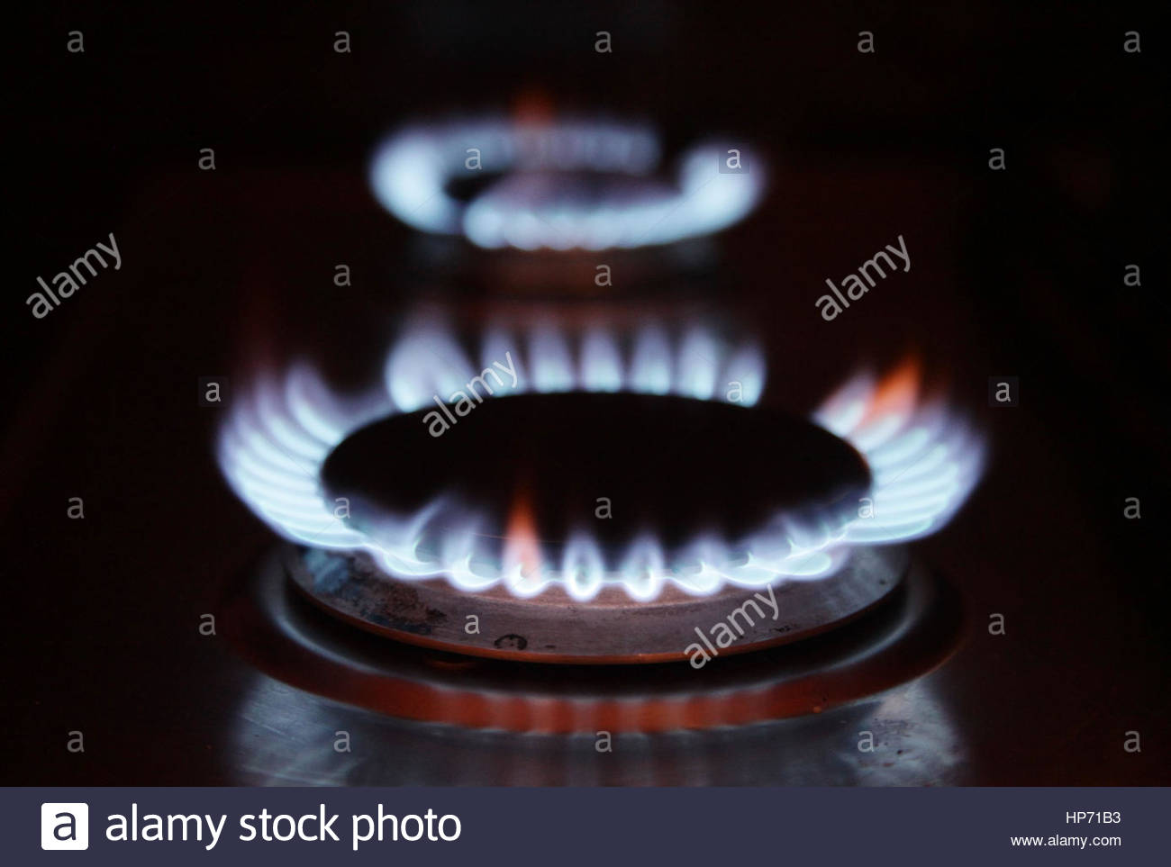 File photo dated 18/01/12 of gas rings on a cooker at a home. Theresa May is being urged to make good her promise - Stock Image